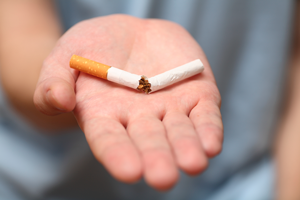 Broken cigarette in the palm of the hand Source: iStockphoto